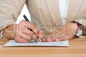 Businesswoman filling insurance contract form in office