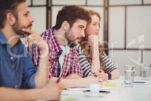 Coworkers sitting at desk in creative office