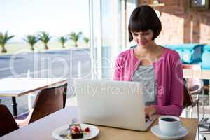Woman using laptop in the coffee shop