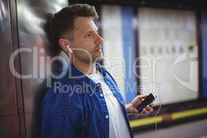 Handsome man listening song on mobile phone
