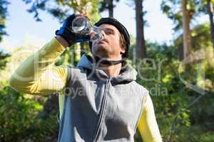 Mountain biker drinking water
