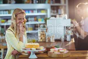 Smiling woman looking at dessert