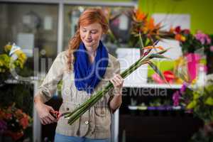 Female florist trimming flower stem