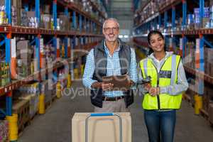 Portrait of warehouse workers working together