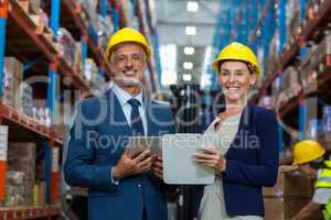 Warehouse manager and client smiling