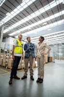 Warehouse managers discussing with the worker