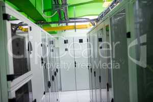 Hallway with a row of servers