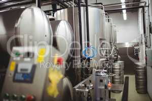 Machinery and kegs in brewery
