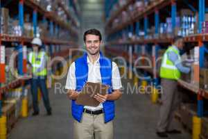 Warehouse worker holding clipboard