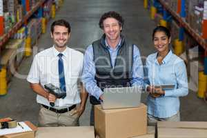Portrait of warehouse manager and worker standing together