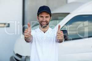 Portrait of delivery man showing thumbs up