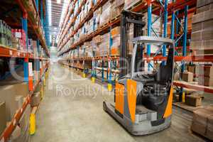 Forklift and cardboxes in shelf