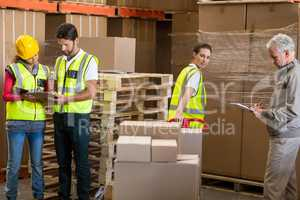 Warehouse manager and workers preparing a shipment