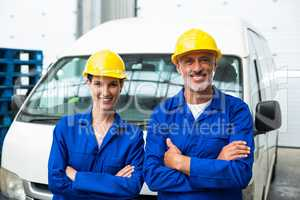 Portrait of warehouse workers standing together with arms crossed
