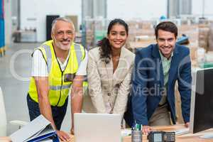 Portrait of warehouse managers and worker working together
