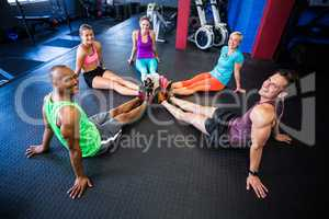 High angle portrait of smiling of friends in gym