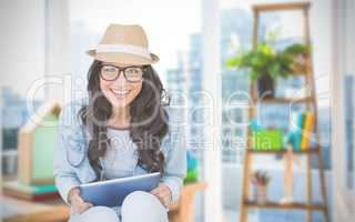 Composite image of brunette with tablet pc