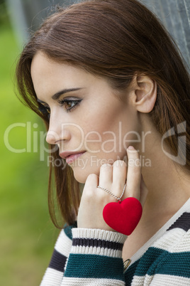 Sad Thoughtful Woman With Red Heart Necklace
