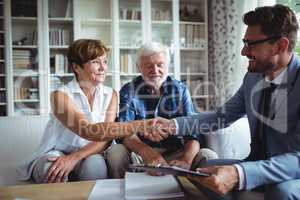 Financial advisor shaking hands with senior woman