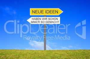 Schild zeigt Neue Ideen oder Haben wir schon immer so gemacht