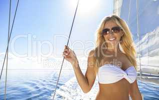 Beautiful Young Blond Woman on a Sail Boat