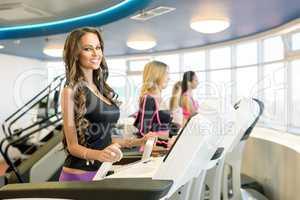 Happy brunette posing while training on simulator