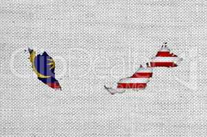 Karte und Fahne von Malaysia auf altem Leinen