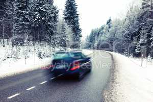 Lonely car on the road in winter landscape