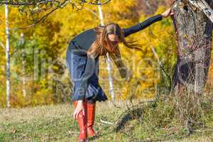 Young brunette on autumn mountain meadow