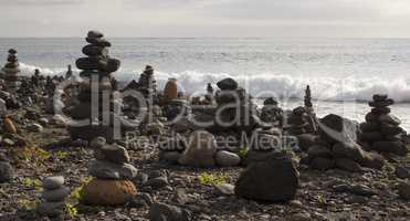 Piles from rocks on the rocky beach