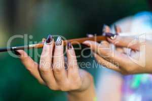 Beautiful women's hands holding mouthpiece