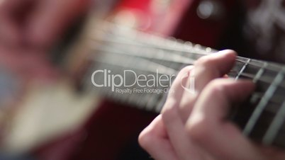 Man playing electric guitar with bend technique