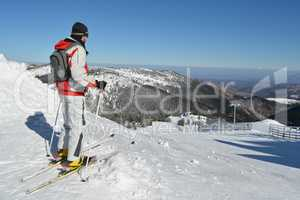 Young sportsman at the top of the ski slope