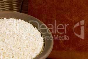 Sesame seeds in a clay plate