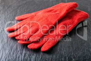 Red gloves on black background
