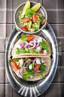 Chicken Tacos with vegetables served on the table