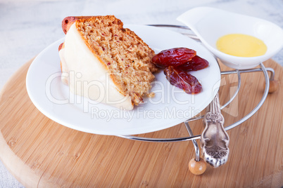 Slice of date cake on a white plate