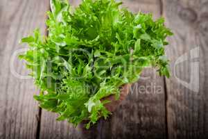Fresh green lettuce on a wooden table