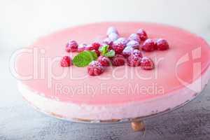 Raspberry yogurt cake with berries on the top