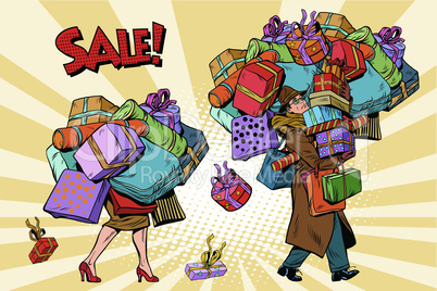 Holiday sales, a couple man and woman with shopping