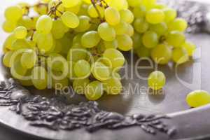 Bunch of white grapes on a tray