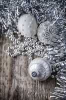 White christmas balls on a wooden background