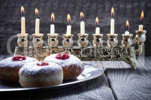 Sufganiyot and nine branched menora for Hanukkah