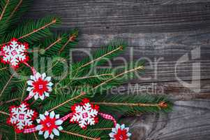 New Year's and Christmas wooden background with decorations and spruce branches
