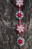Snowflakes of felt on a red ribbon