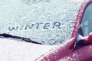 Word Winter written on a car windshield