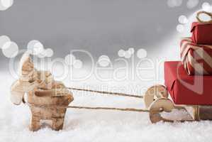 Reindeer With Sled, Silver Bokeh Background, Copy Space