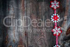 Felt snowflakes on a red ribbon to the left the empty space