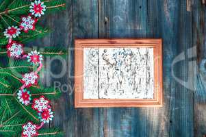 empty wooden frame for Christmas lettering decorated with fir br