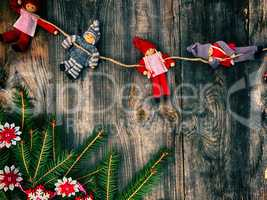 Textile Christmas toys on gray old wooden background